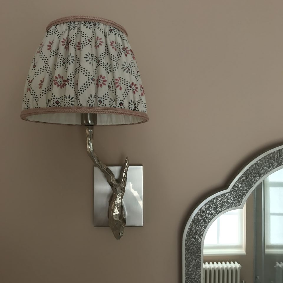 A beautiful wall light with a bespoke shade