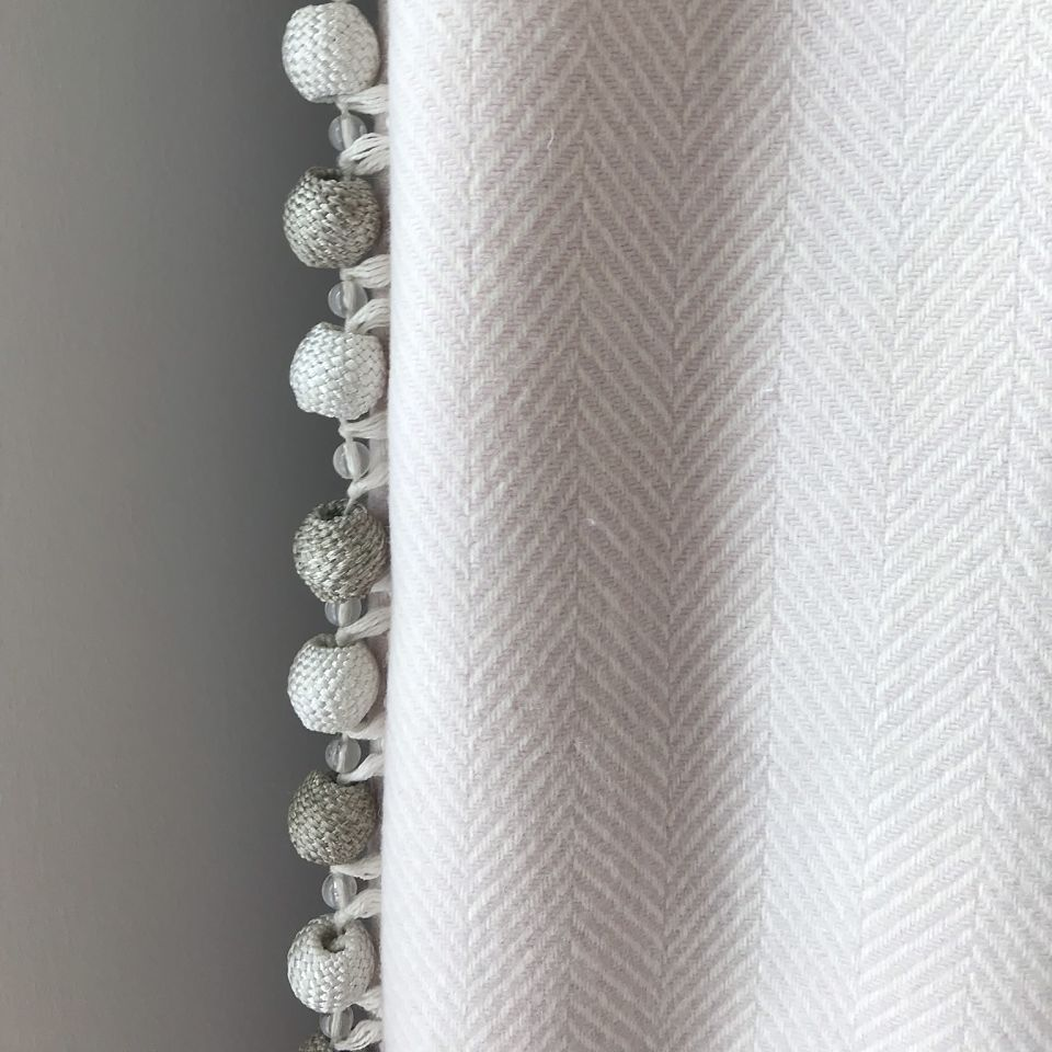 Detail of curtain with trimming